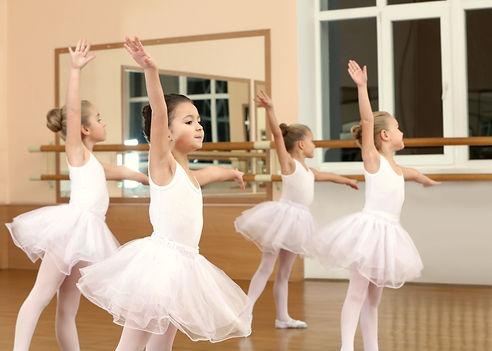 Group of beautiful little girls practici
