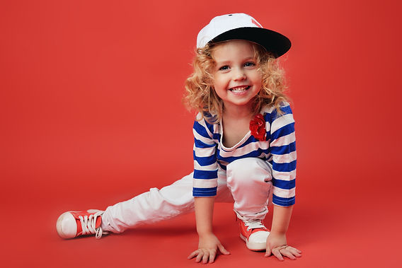 Portrait of a cute little girl in fashio