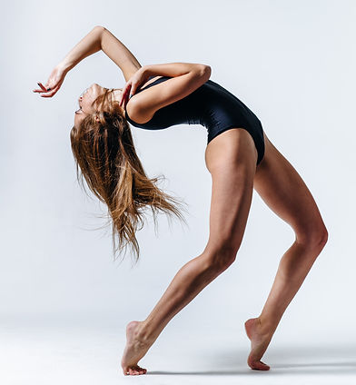young beautiful dancer posing in studio.