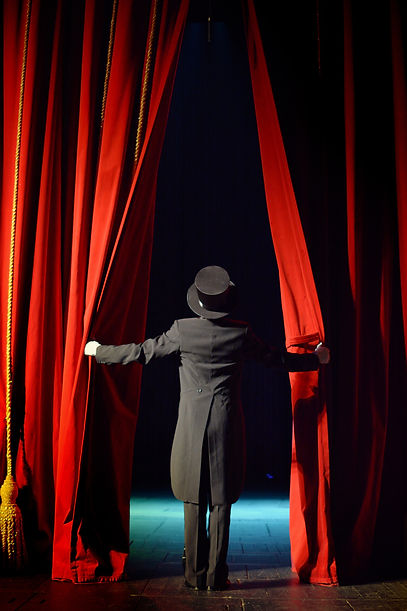 the actor opens a theater curtain.jpg