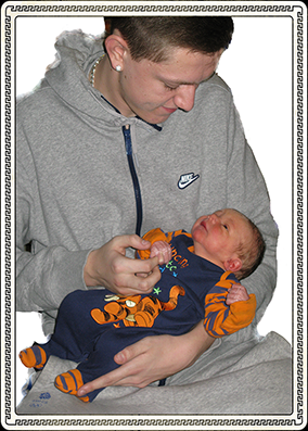 new born baby and a man