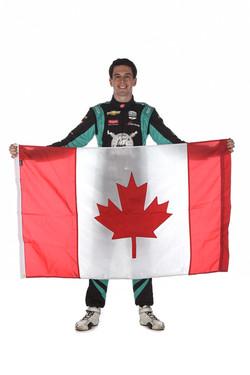 Dalton Kellett holding the Canadian Flag
