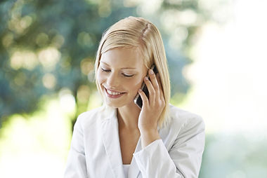 Smiling blonde woman on cellphone