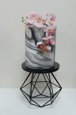 Extra tall marbled orchid cake