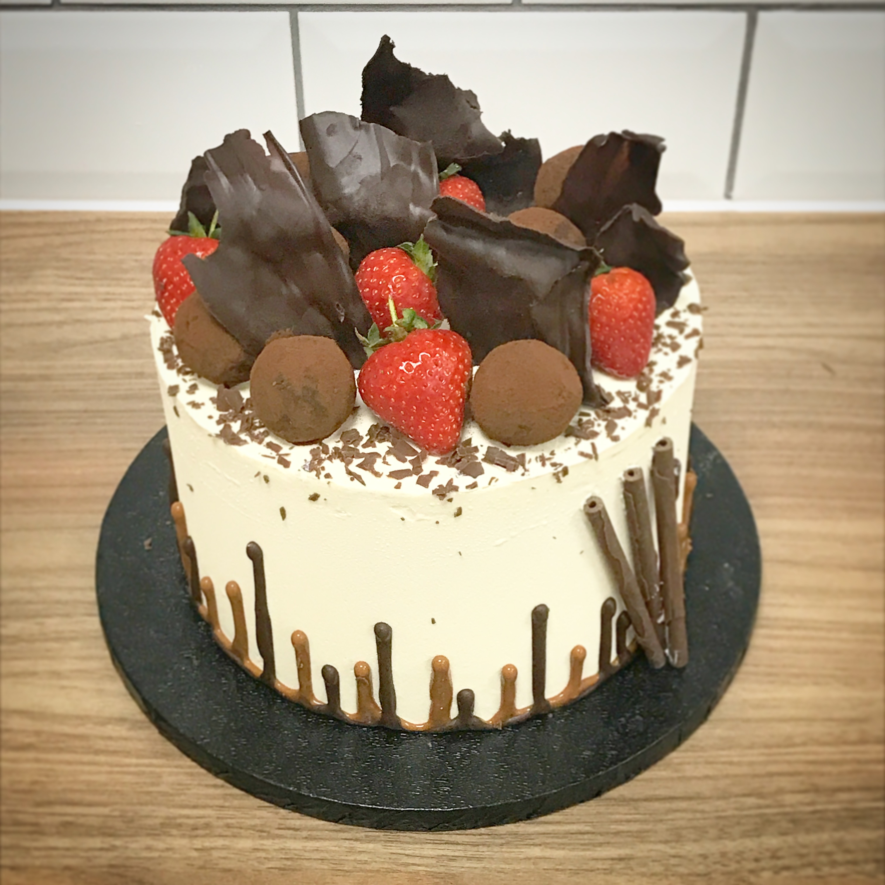 Upsidedown Drip Cake with Chocolate Sails, Homemade Truffles and Strawberries