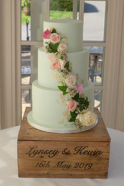 Pale Green Wedding Cake with Cascading F