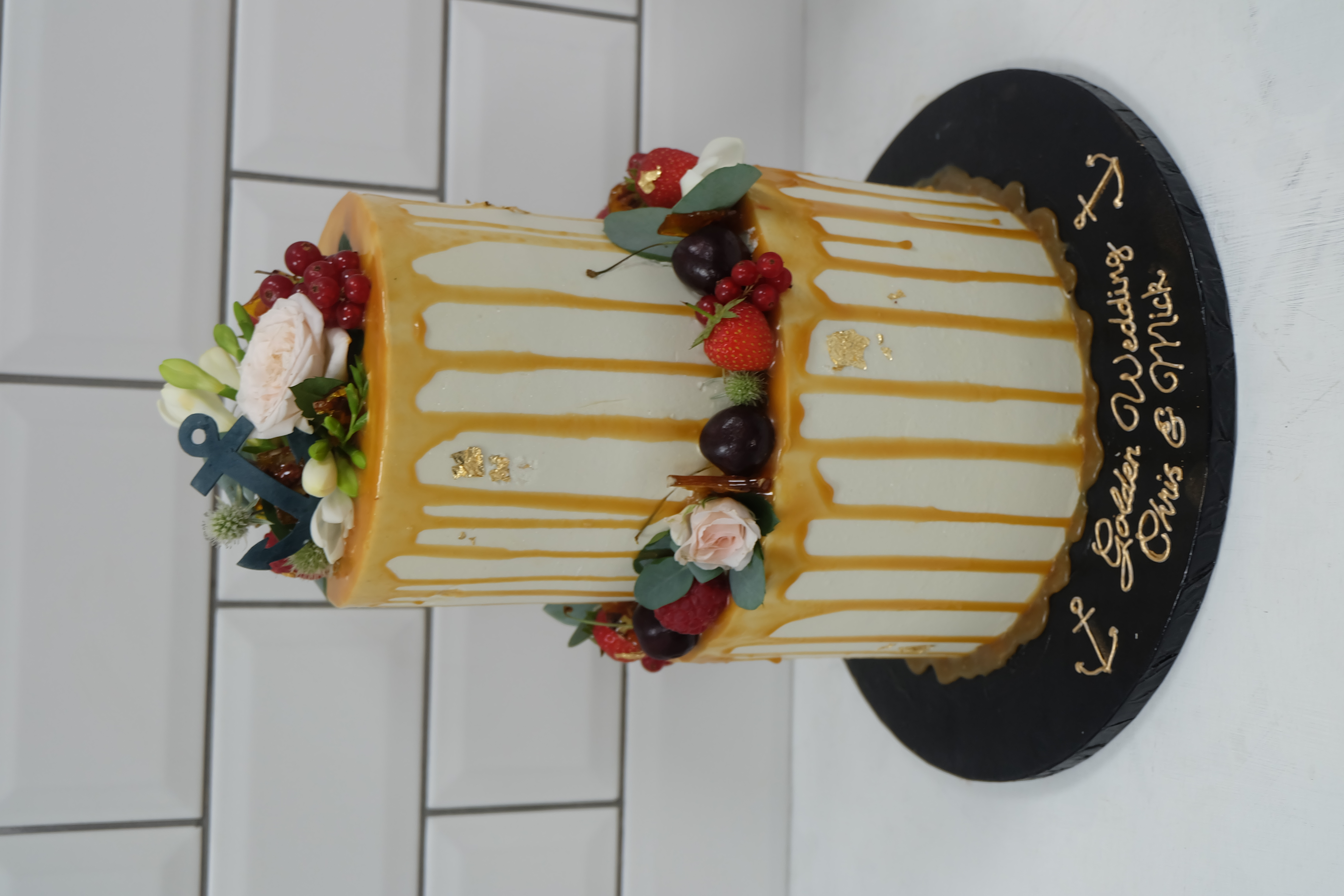 Caramel Drip Cake with Fruits and Flower