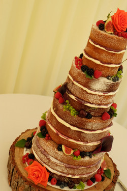 Four Tier Naked Wedding Cake with Fruits and Flowers