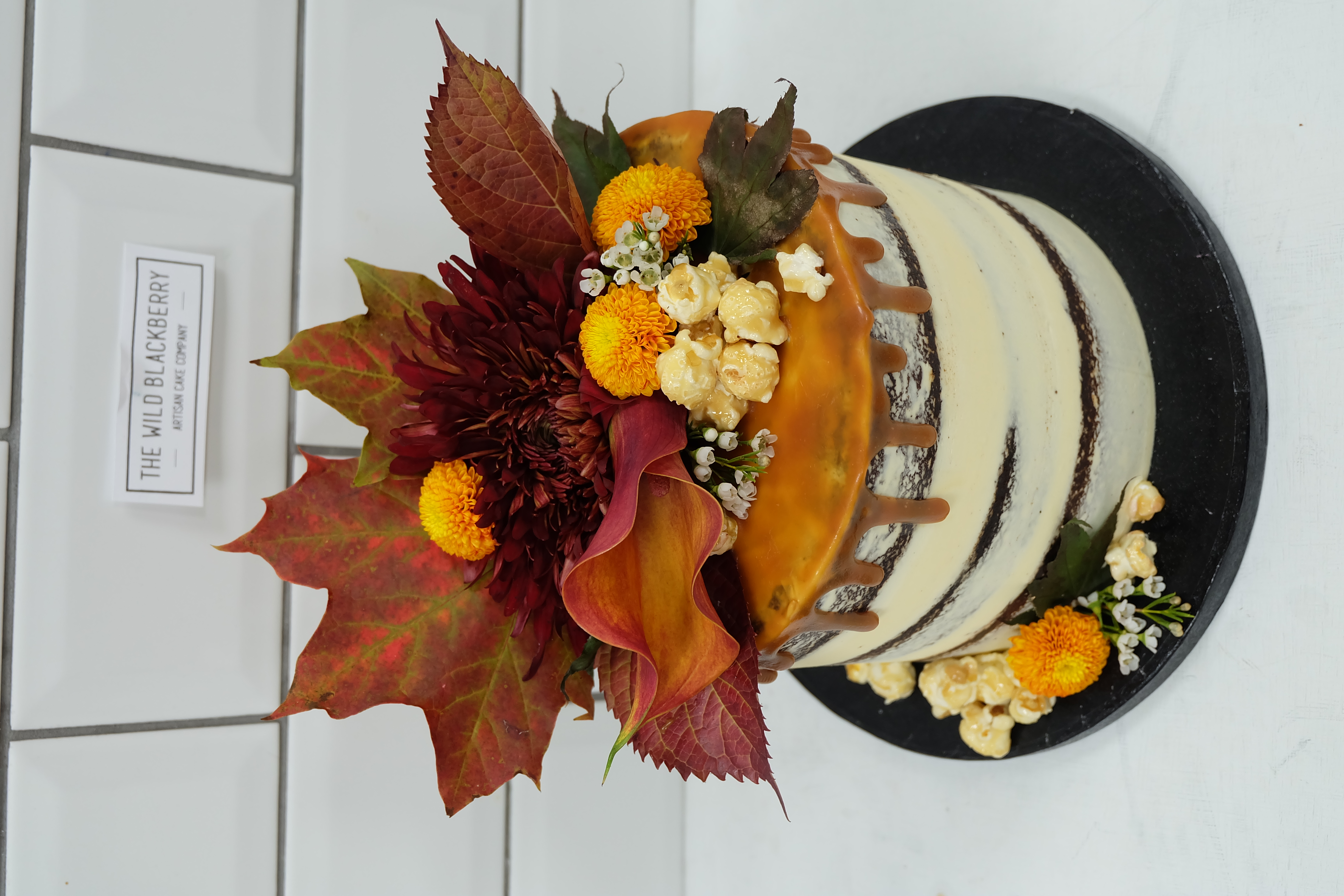 Semi-Naked Caramel Drip Cake with Autumn