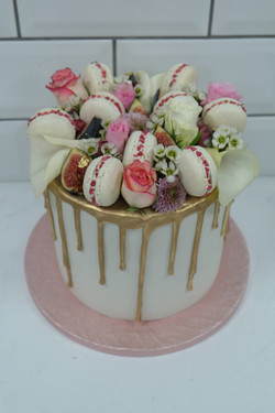 Flowers, macarons, figs gold drip cake