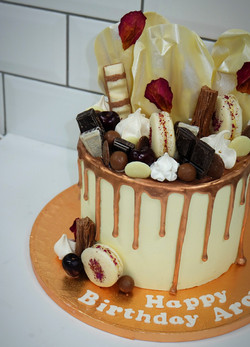 White chocolate and copper drip cake with chocolate sails and macarons 3_edited