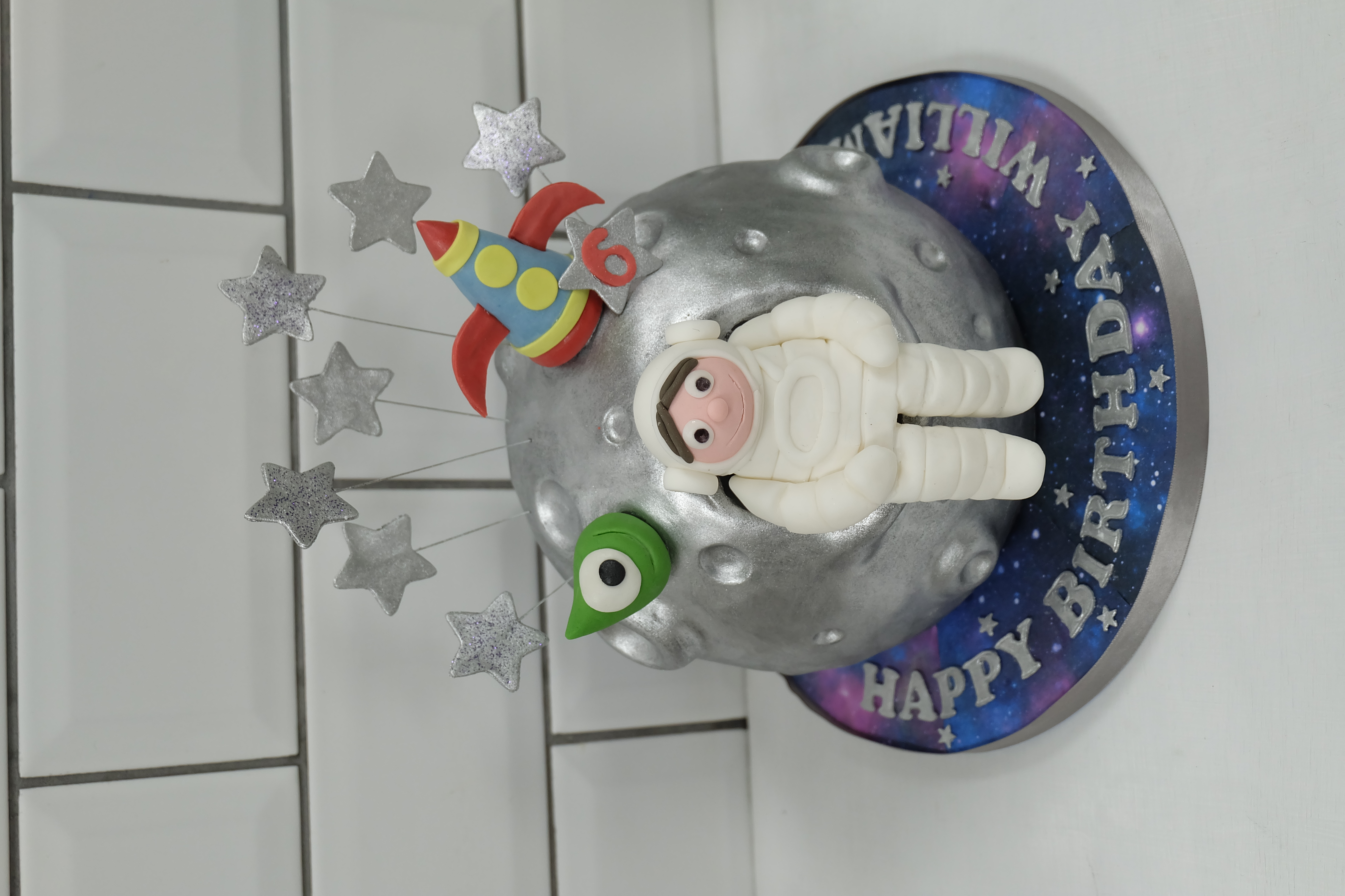 Spaceman on the moon birthday cake