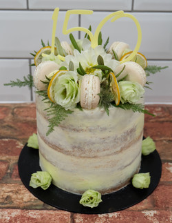 Semi Naked Cake with Fresh Flowers, Foliage, Macarons and Lemon