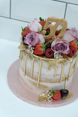 Fruits, roses and gold drip cake