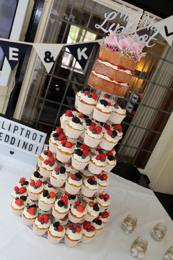 Cupcake Tower Wedding Cake with Naked Top Cake Decorated with Berries4