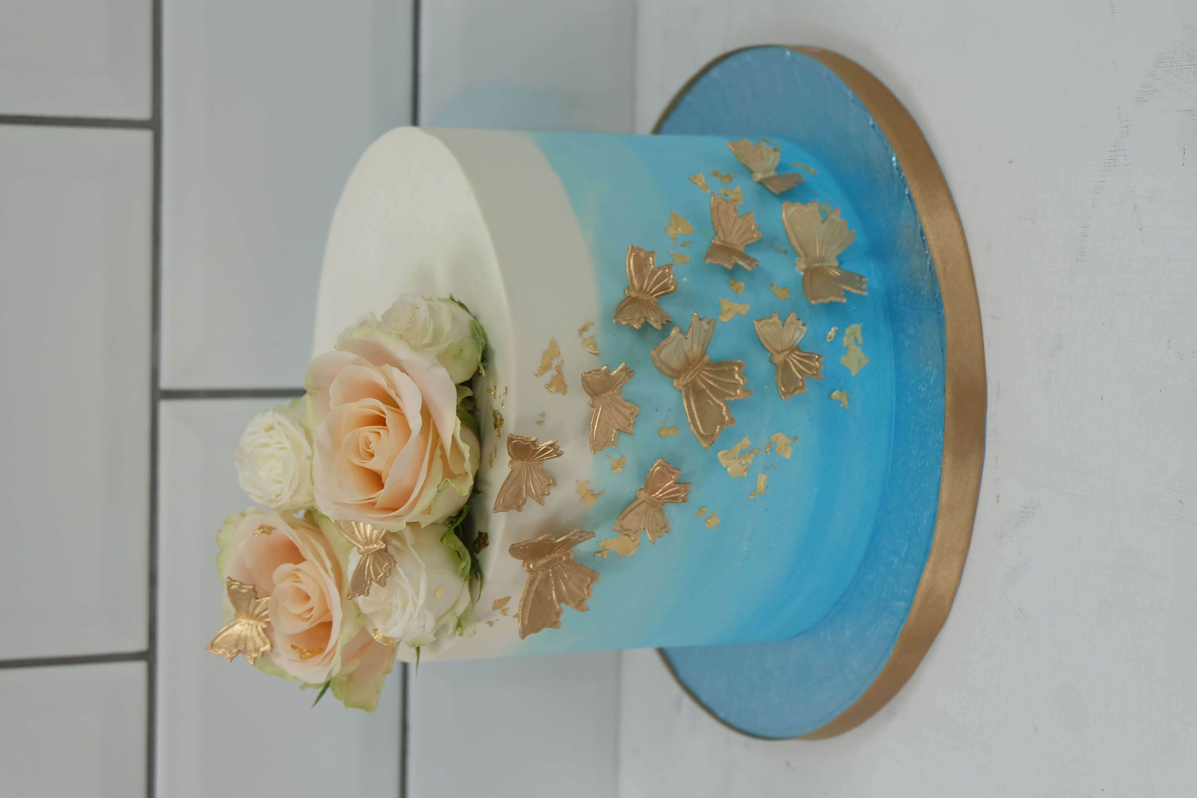 Blue ombre cake gold butterflies, gold l