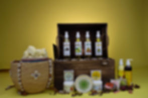 Serenity hair and body products with shea butter in an african designed basket and oils in a box.