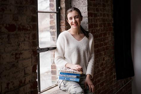 Anna+Welsh+with+books+photo+credit+Versa