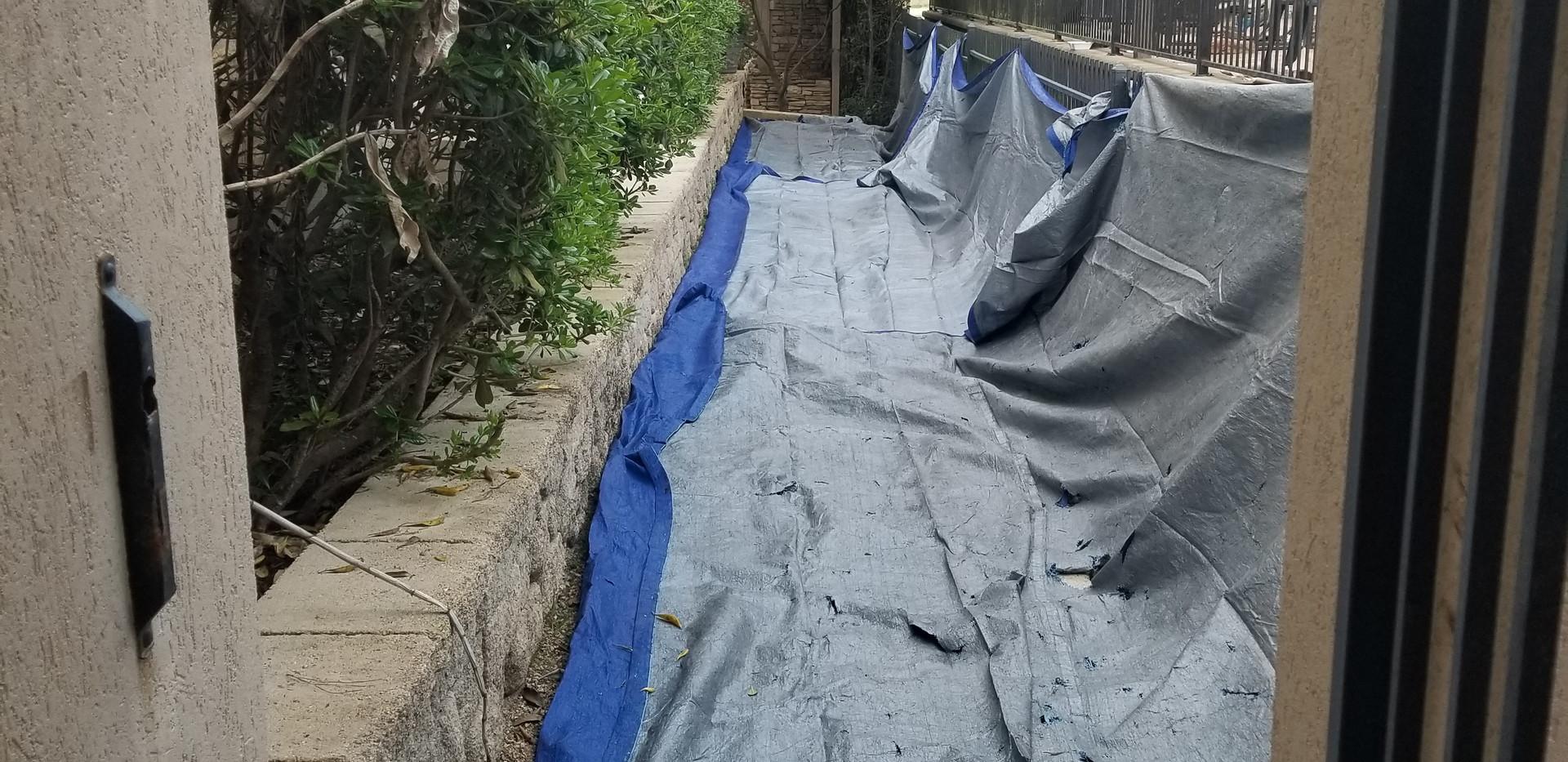 Utilizing tarps to catch falling debris