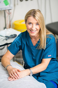 Portrait of a woman paediatrician in her practice