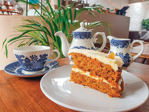 Cake and a pot of loose leaf tea.