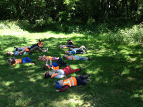 Enjoying a quiet moment in the woods doing yoga