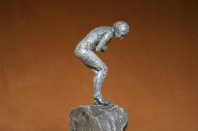 Vulnerability, patinated bronze resin, Cornish slate