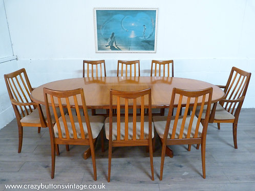 G Plan oval extending dining table and 8 chairs incl 2 carvers