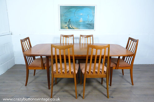 G Plan teak table and 6 chairs 2 carvers