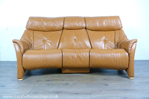 Himolla Cumuly cognac curved reclining sofa