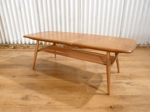 Beautiful Ercol Windsor Golden Dawn coffee table with magazine rack