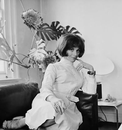 Fenella Fielding portrait at home in her Marble Arch penthouse in the 1960s Sitting on Bastiana sofa from Aram on Kings Road
