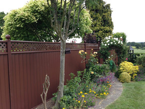 fenced in garden with wedge stone boarde