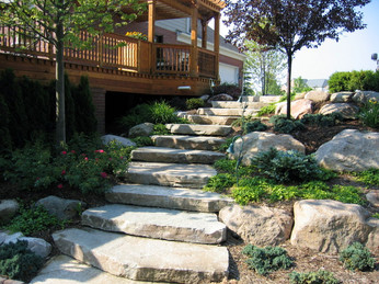 ledge stone stairs and tiered garden.jpg