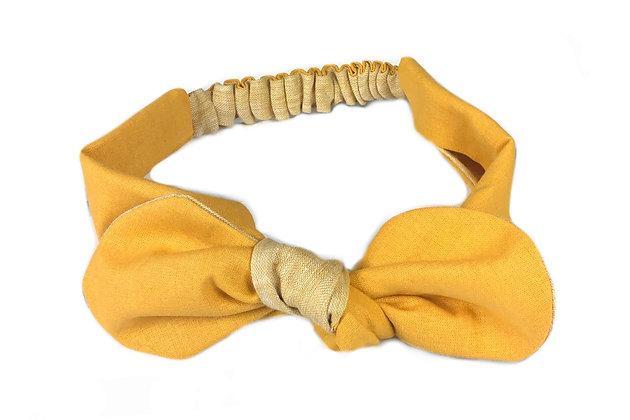 Handmade mustard colour baby girl headband front view