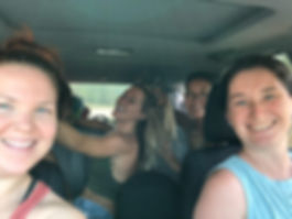 four women in a car smiling during a womens reiki retreat