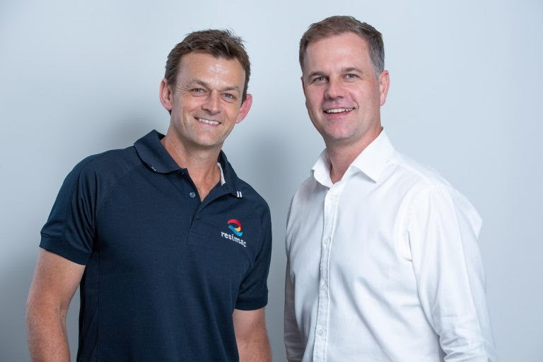 Adam Gilchrist poses with his Resimac polo shirt after being announced as brand ambassador.