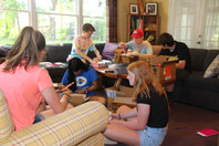 Youth Volunteers creating Open House giveaways