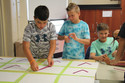 Middle Schoolers making a bulletin board to help persuade peers to make healthy choices