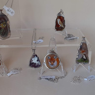 Wendy Sabine. Hand painted animal and bird minitures on agate set in silver.
