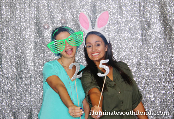 Custom photo booth props for a 25 year anniversary celebration for a company in Boca Raton - corporate photo booth rental provided by ILLUMINATE South Florida Photo Booth