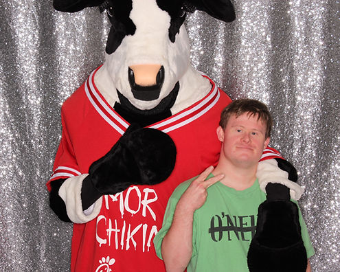 employee appreciation day for company anniversary party with Chick-Fil-A cow.  Branded prints with logo and service by ILLUMINATE South Florida Photo Booth