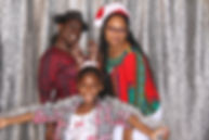 Family holiday party entertainment with an open photo booth and props provided by ILLUMINATE South Florida Photo Booth in Fort Lauderdale, Broward County