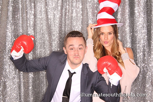 Teachers with fun props for the photo booth at high school prom in Fort Lauderdale, Broward County.  Photo Booth rental service by ILLUMINATE South Florida Photo Booth.
