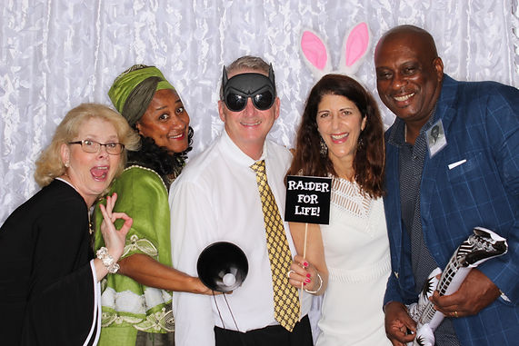 Former classmates letting loose with fun props at their 40 year reunion in Fort Lauderdale, Broward County, Florida