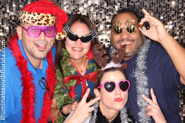 fun company holiday party photo booth in Fort Lauderdale, Broward County.  Corporate photo booth with branded prints provided by ILLUMINATE South Florida.