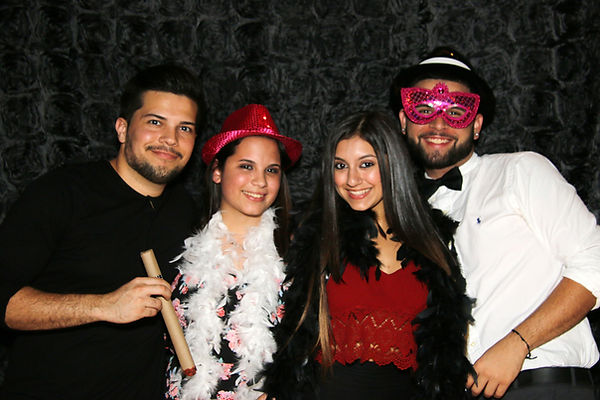 Young people posing with stylish photo booth props at birthday celebration - Miami, Dade County - ILLUMINATE South Florida Photo Booth