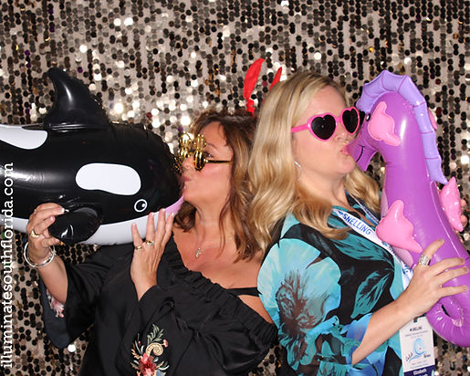 Photo booth with custom props and branded prints at national corporate awards ceremony in Miami.  Provided by ILLUMINATE South Florida Photo Booth