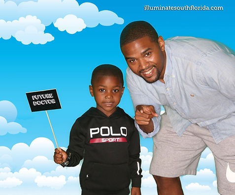 Father and son posing for green screen photo booth at Broward College in Pembroke Pines, Broward County - ILLUMINATE South Florida Photo Booth rental