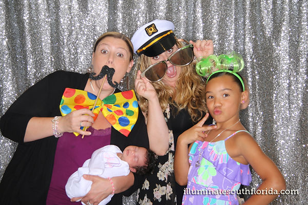 Family in a fun photo booth picture at non-profit charity fundraiser event in Fort Lauderdale, Broward County - ILLUMINATE South Florida Photo Booth